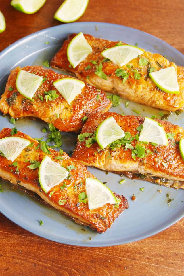 "<div>Our new favorite way to eat salmon.</div><div>Get the recipe from <a rel=""nofollow"" href=""http://www.delish.com/cooking/recipe-ideas/recipes/a52015/honey-cilantro-lime-salmon-recipe/"">Delish</a>.</div>"