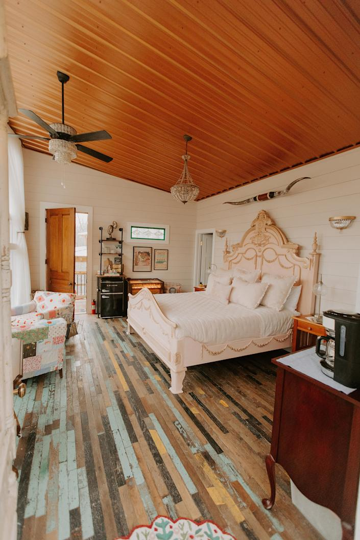 The bedroom's colorful wood floors are reclaimed from a mid-20th century manufacturing plant that custom-made uniforms for almost every major league baseball team around from 1946 to 1949. Photo credit: Zach and Sarah Photography.