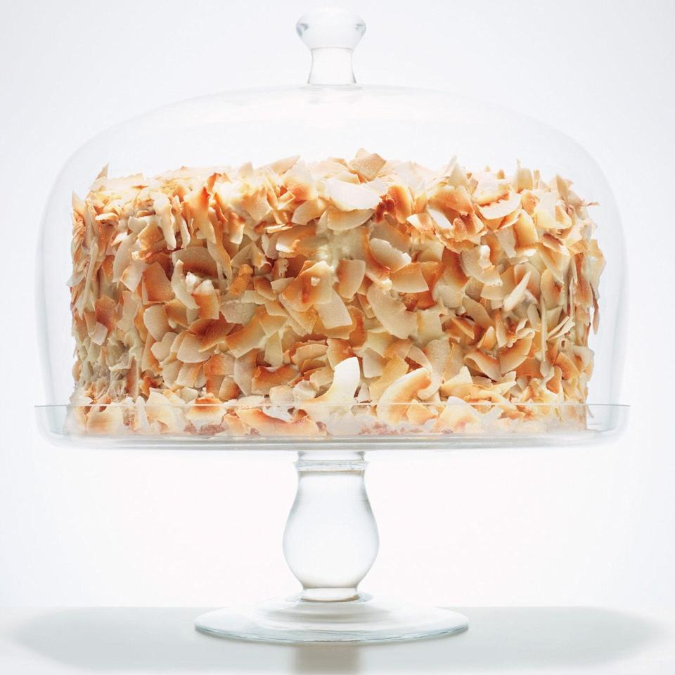 """Don't let the good looks of this eight-layer beauty fool you; it's easy to make. Bake four cakes (we used 9"""" round metal cake pans, but disposable ones work fine), then slice each in half. Finish with toasted coconut, a knockout garnish that's also forgiving—it'll mask a less-than-perfect frosting job. <a href=""""https://www.epicurious.com/recipes/food/views/coconut-southern-comfort-layer-cake-388659?mbid=synd_yahoo_rss"""" rel=""""nofollow noopener"""" target=""""_blank"""" data-ylk=""""slk:See recipe."""" class=""""link rapid-noclick-resp"""">See recipe.</a>"""