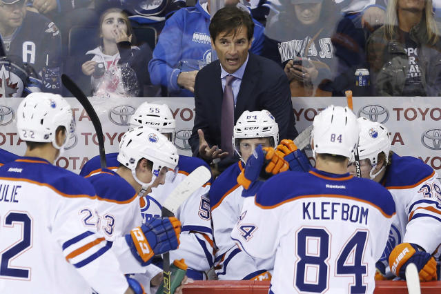 FILE - In this Sept. 24, 2014, file photo, Edmonton Oilers coach Dallas Eakins talks to his team during a timeout during the first period of an NHL preseason hockey game against the Winnipeg Jets, in Winnipeg, Manitoba. Dallas Eakins is the Anaheim Ducks' new coach. The Ducks announced the move Monday, June 17, 2019, filling the NHL's last head coaching vacancy with the veteran coach of their AHL affiliate in San Diego. (AP Photo/The Canadian Press, John Woods, File)