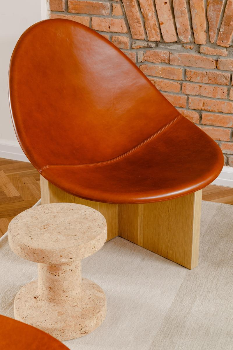 """The Estudio Persona Nido Chairs were a splurge. """"I really had to convince Chris,"""" Claire confesses. But their timeless shape and sculptural silhouette made them ideal for the transitional space, where they will be on view at all angles. The cork side tables are from Vitra."""