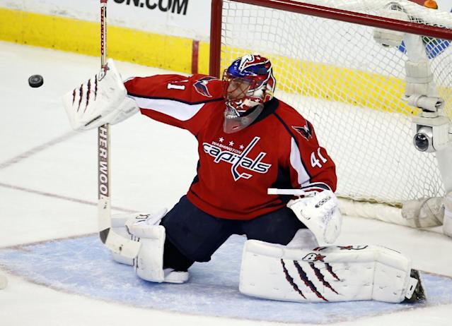 Washington Capitals goalie Jaroslav Halak (41), from the Czech Republic, deflects a shot in the third period of an NHL hockey game against the Chicago Blackhawks, Friday, April 11, 2014, in Washington. The Capitals won 4-0. (AP Photo/Alex Brandon)
