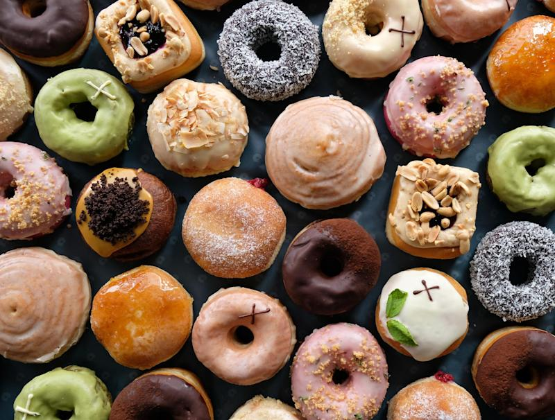 Pretty dough: Deliveroo riders will be handing out the doughnuts from 6pm today