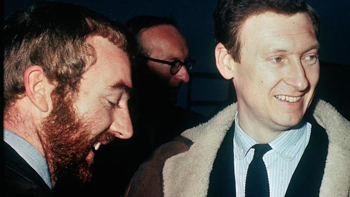 British journalist Anthony Grey (left), smiles upon arrival at London Airport from Karachi