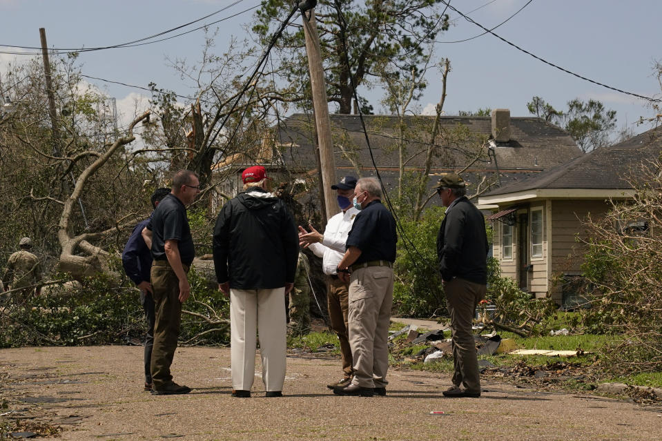 President Donald Trump tours damage from Hurricane Laura, Saturday, Aug. 29, 2020, in Lake Charles, La. (AP Photo/Alex Brandon)