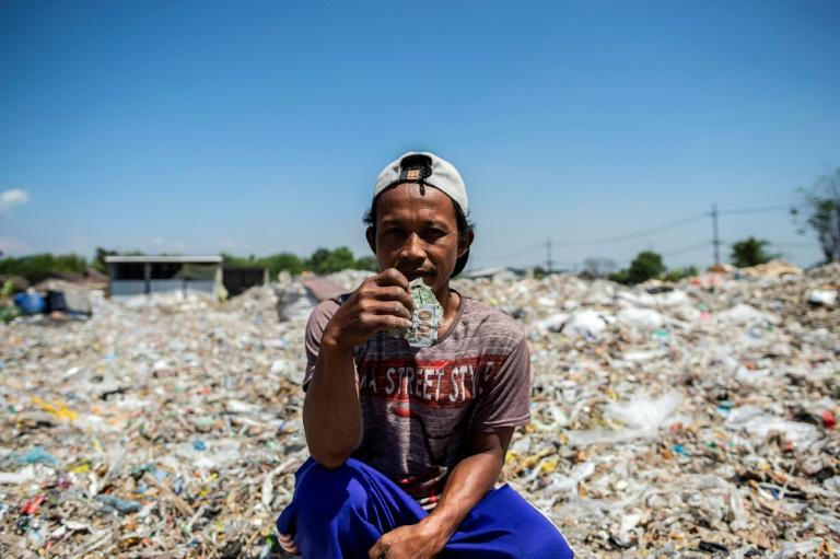 Residents in the Indonesian town of Bangun are basking in a waste-picking boom, as levels of imported trash soar (AFP Photo/Juni Kriswanto)