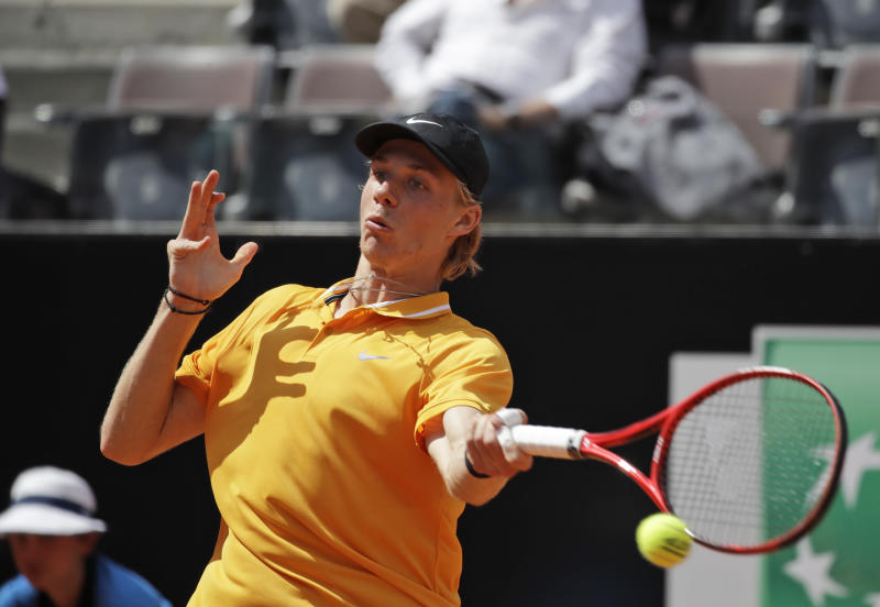 FILE - In this Thursday, May, 16, 2019 file photo, Canada's Denis Shapovalov returns the ball to Serbia's Novak Djokovic at the Italian Open tennis tournament, in Rome. Its typically Canadian that Denis Shapovalov, Felix Auger-Aliassime and Bianca Andreescu are each children of immigrants. Whats not typical is that they have all simultaneously broken into the worlds elite ranks of tennis players _ and will all be worth watching when the French Open begins Sunday. (AP Photo/Alessandra Tarantino, File)