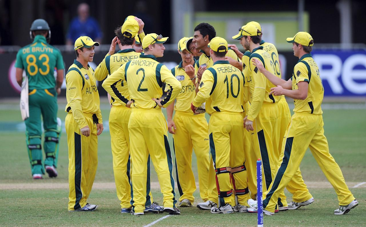 TOWNSVILLE, AUSTRALIA - AUGUST 21:  Gurinder Sandhu of Australia (C) celebrates with team-mates after taking the wicket of Theunis De Bruyn of South Africa during the ICC U19 Cricket World Cup 2012 Semi Final match between Australia and South Africa at Tony Ireland Stadium on August 21, 2012 in Townsville, Australia.  (Photo by Malcolm Fairclough-ICC/Getty Images)