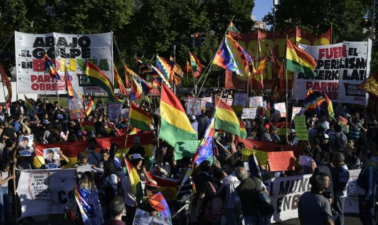 New elections are seen as key to ending Bolivia's worst political upheaval in 16 years, which has deepened divisions between Evo Morales's supporters (pictured November 22, 2019) and Bolivia's upper and middle classes