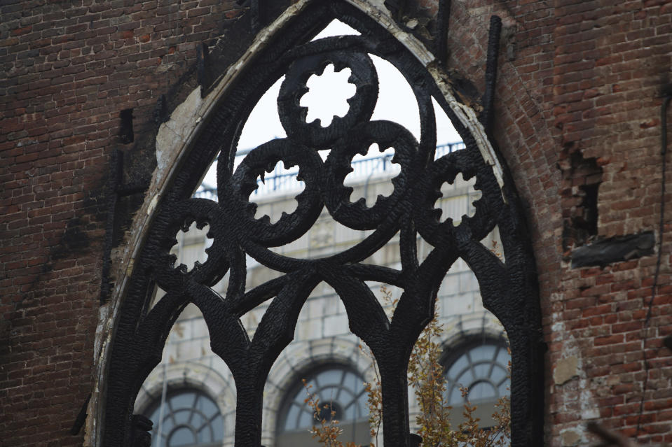 The iron frame that once held Tiffany glass windows in the sanctuary at Middle Collegiate Church is seen in New York on Dec. 14, 2020. After a devastating fire earlier in the month, the facade and the New York Liberty Bell are the only parts of the 128-year-old church that remain. (AP Photo/Emily Leshner)
