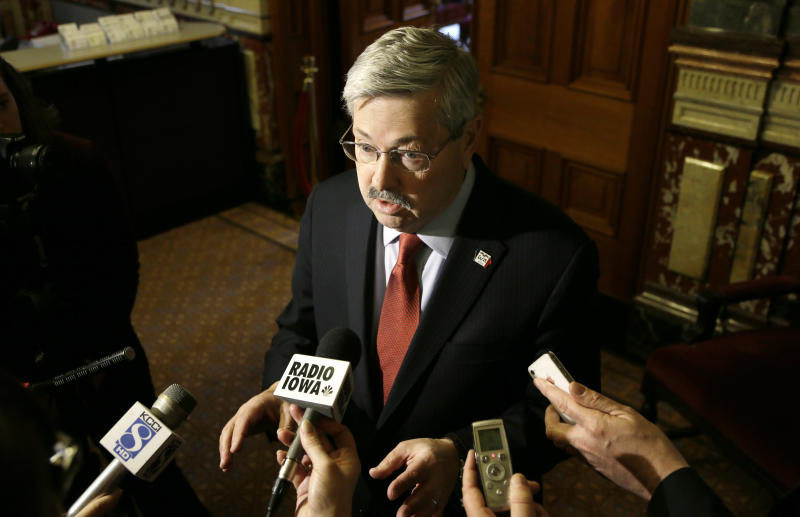 FILE - In this April 9, 2014 file photo, Iowa Gov. Terry Branstad speaks to reporters outside his formal office at the Statehouse in Des Moines, Iowa. Branstad is fending off multiple mini-scandals and has become a political target in a mid-term campaign that was supposed to be about the Democratic president's problems, not his. Republicans worry that the turmoil will roil the political waters as they attempt to win a U.S. Senate seat and control of the state Senate. (AP Photo/Charlie Neibergall)
