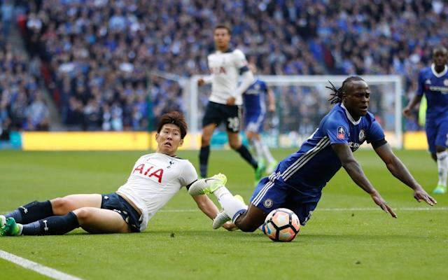 <span>Heung-Min Son gifted Chelsea a penalty when he brought down Victor Moses just before the break</span> <span>Credit: Reuters </span>