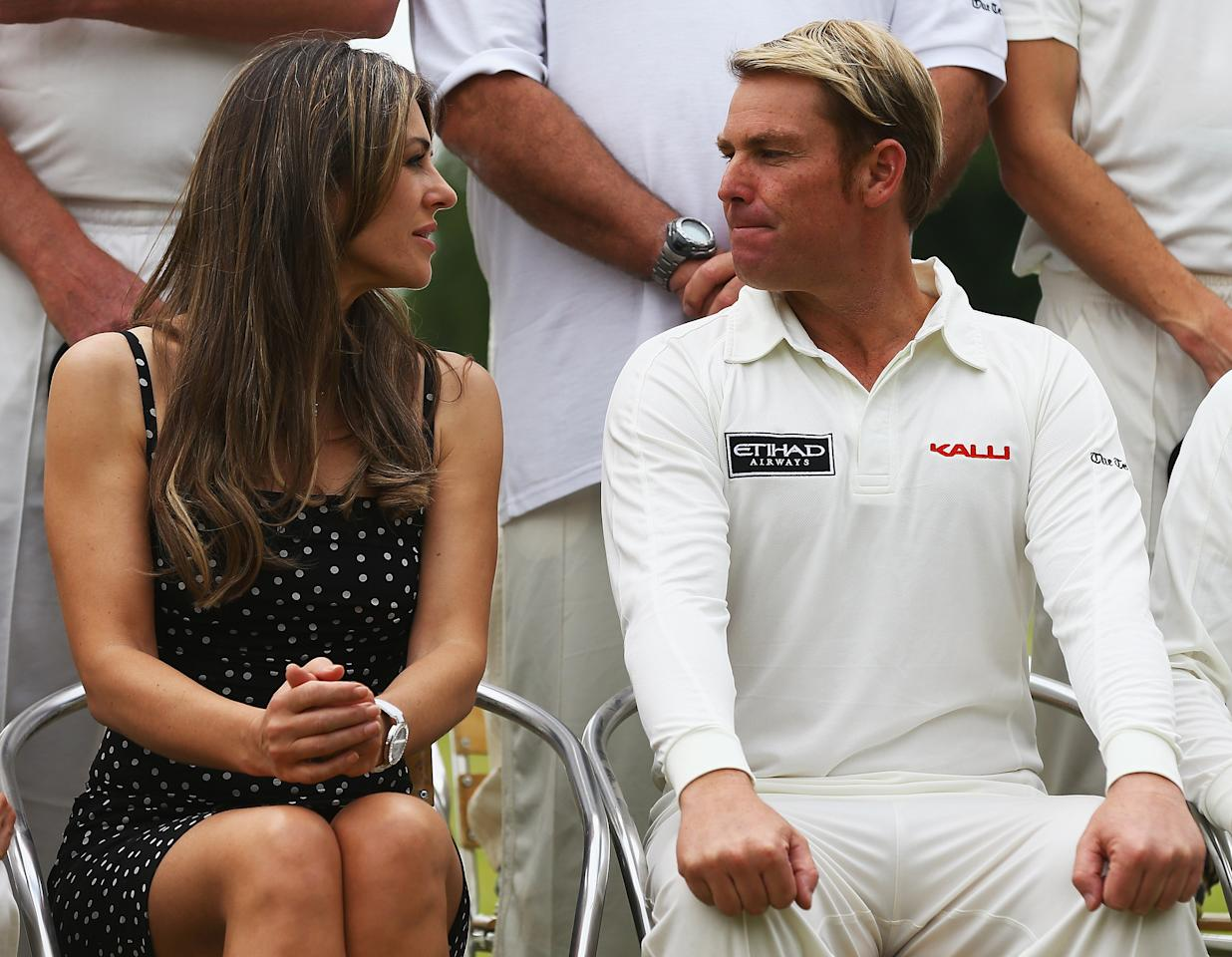 CIRENCESTER, ENGLAND - JUNE 09:  Elizabeth Hurley and Shane Warne look on during the Shane Warne's Australia vs Michael Vaughan's England T20 match at Circenster Cricket Club on June 9, 2013 in Cirencester, England.  (Photo by Matthew Lewis/Getty Images)