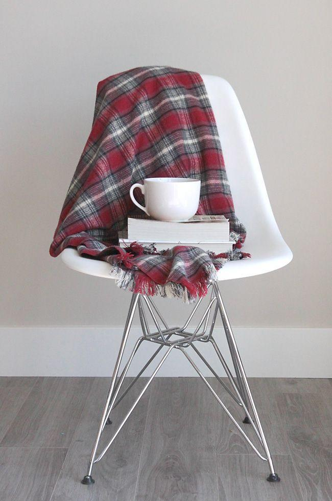 """<p>You can make this cozy throw for your pop, which is perfect for tailgating and movie watching, for less than $10. </p><p><strong>Get the tutorial at <a href=""""https://www.itsalwaysautumn.com/easy-diy-fringed-flannel-throw-great-gift-idea.html"""" rel=""""nofollow noopener"""" target=""""_blank"""" data-ylk=""""slk:It's Always Autumn"""" class=""""link rapid-noclick-resp"""">It's Always Autumn</a>.</strong></p><p><strong><a class=""""link rapid-noclick-resp"""" href=""""https://www.amazon.com/Newcastle-Fabrics-Flannel-Plaid-Fabric/dp/B017L4ZJO4/?tag=syn-yahoo-20&ascsubtag=%5Bartid%7C10050.g.1171%5Bsrc%7Cyahoo-us"""" rel=""""nofollow noopener"""" target=""""_blank"""" data-ylk=""""slk:SHOP FLANNEL FABRIC"""">SHOP FLANNEL FABRIC</a><br></strong></p>"""