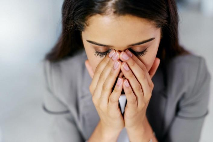 Woman stressed out in an office