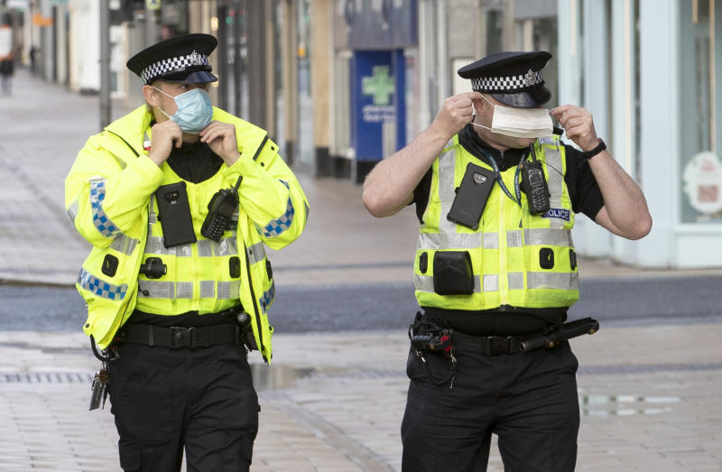 Police patrol alongside the queue outside the Primark store on Princes Street in Edinburgh, which reopens today as part of Scotland's phased plan to ease out of the coronavirus pandemic lockdown.