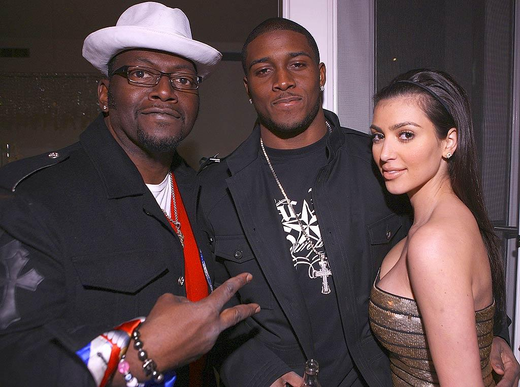 """Randy Jackson flashes the peace sign as he, NFL star Reggie Bush, and reality TV vixen Kim Kardashian chill at Details magazine's """"Mavericks 2008"""" party in Beverly Hills. Chris Weeks/<a href=""""http://www.wireimage.com"""" target=""""new"""">WireImage.com</a> - March 20, 2008"""