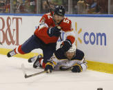 Florida Panthers defenseman MacKenzie Weegar (52) Buffalo Sabres center Johan Larsson (22) battle for the puck during the first period of an NHL hockey game, Friday, March 2, 2018, in Sunrise, Fla. (AP Photo/Wilfredo Lee)