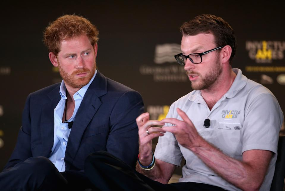 ORLANDO, FL - MAY 08:  Prince Harry and Royal Marine veteran JJ Chalmers talk at a Symposium of Invisable Wounds at the Shades of Green resort at Invictus Games Orlando 2016 at ESPN Wide World of Sports on May 8, 2016 in Orlando, Florida. Prince Harry, patron of the  Invictus Games Foundation is in Orlando ahead of the opening of Invictus Games which will open on Sunday. The Invictus Games is the only International sporting event for wounded, injured and sick servicemen and women. Started in 2014 by Prince Harry the Invictus Games uses the power of Sport to inspire recovery and support rehabilitation.  (Photo by Chris Jackson/Getty Images for Invictus Games)