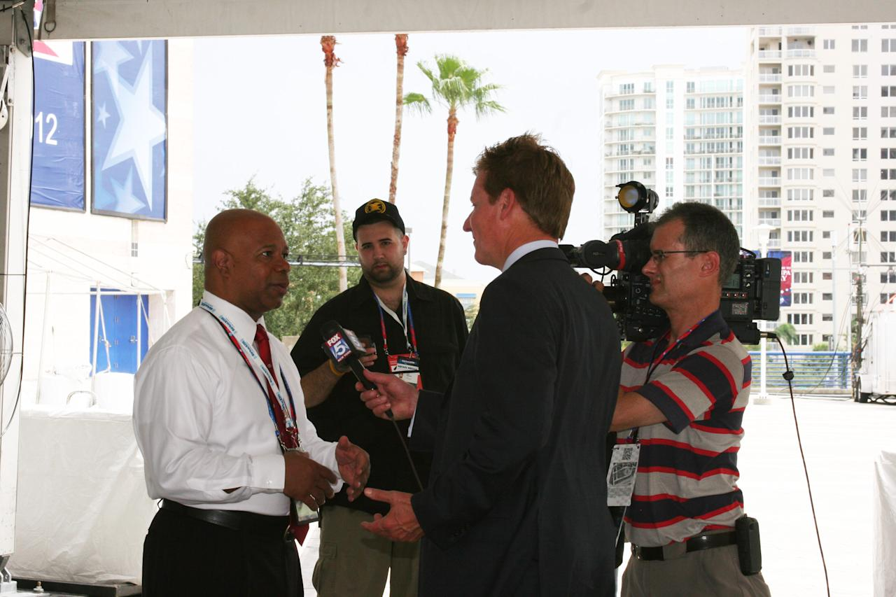 A journalist interviews Rep. Tim Scott of South Carolina outside the forum at the Republican National Convention on Monday, Aug. 27, 2012. (Torrey AndersonSchoepe/Yahoo! News)