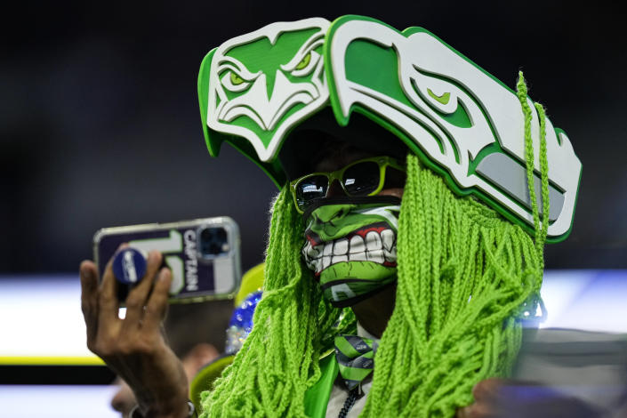 A Seattle Seahawks fans takes a photo before an NFL football game between the Seattle Seahawks and Indianapolis Colts in Indianapolis, Sunday, Sept. 12, 2021. (AP Photo/AJ Mast)