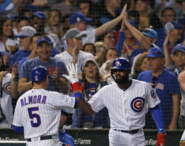 Chicago Cubs' Albert Almora Jr., left, celebrates with teammate Jason Heyward after Almora scored during the sixth inning of the second baseball game of a doubleheader against the St. Louis Cardinals. on Saturday, July 21, 2018, in Chicago. (AP Photo/Jim Young)