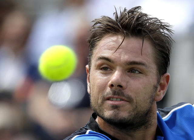 Stan Wawrinka of Switzerland plays a return to Sam Querrey of the USA during their singles tennis match at the Queen's Club tennis tournament in London, Wednesday, June 20, 2018. (AP Photo/Kirsty Wigglesworth)