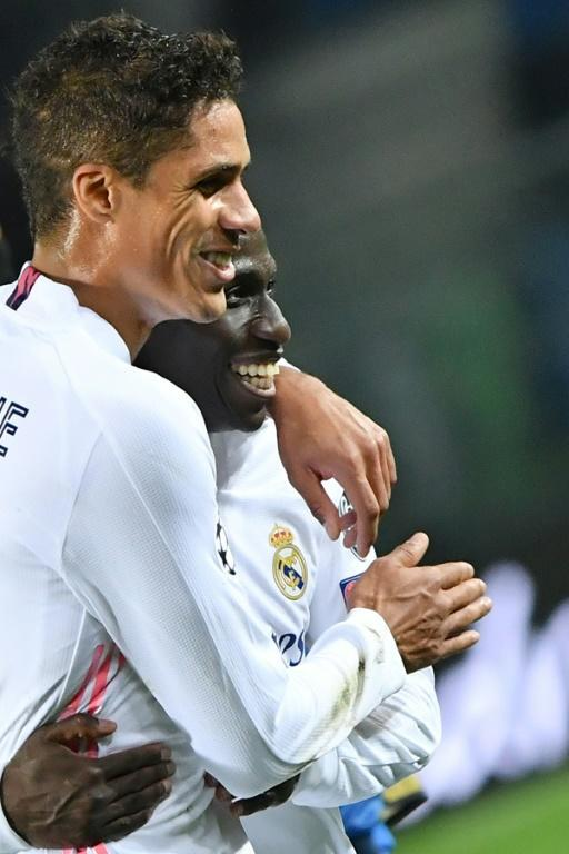 Real Madrid's Raphael Varane (L) congratulates fellow French defender Ferland Mendy after his first Champions League goal.