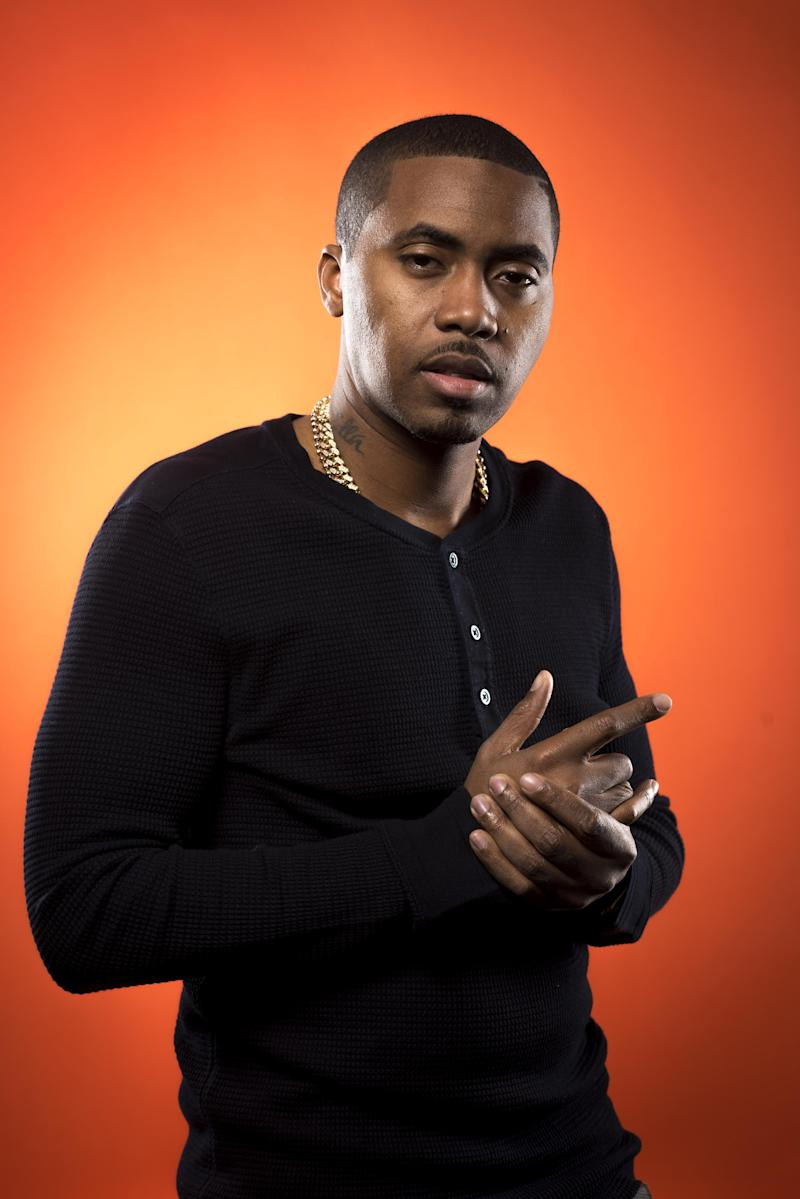 """This Dec. 20, 2012 photo shows American rapper and actor Nas, born Nasir Jones, in New York. Nas is nominated for four Grammys, including best rap album for """"Life Is Good,"""" best rap song and best rap performance for """"Daughters,"""" and best rap/sung collaboration for """"Cherry Wine,"""" which features the late Amy Winehouse. The Grammy Awards will air live Feb. 10. (Photo by Scott Gries/Invision/AP Images)"""
