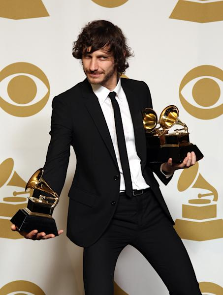 """Gotye poses backstage with the awards for best pop duo/group performance of the year and record of the year for """"Somebody That I Used to Know"""" at the 55th annual Grammy Awards on Sunday, Feb. 10, 2013, in Los Angeles. (Photo by Matt Sayles/Invision/AP)"""