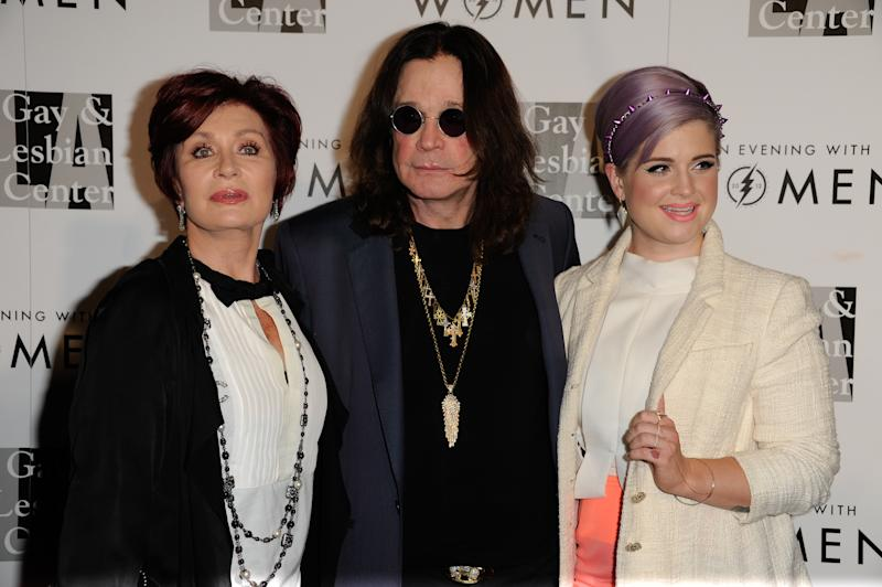 "From left, Sharon Osbourne, Ozzy Osbourne, and Kelly Osbourne arrive at the 2013 ""An Evening With Women"" event at the Beverly Hilton Hotel on Saturday, May 18, 2013 in Los Angeles. (Photo by Richard Shotwell/Invision/AP)"