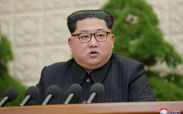 North Korean leader Kim Jong Un speaks during the Third Plenary Meeting of the Seventh Central Committee of the Workers' Party of Korea  - REUTERS