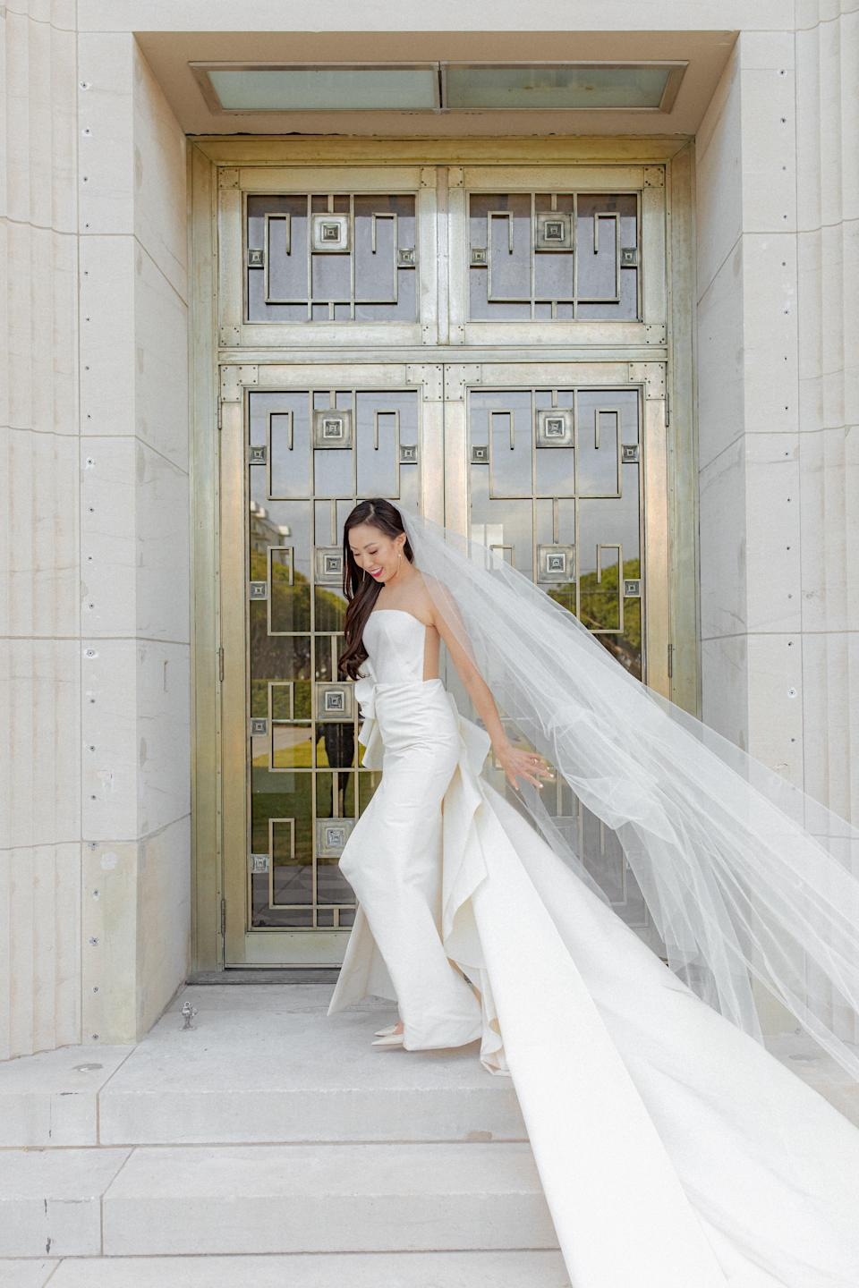 <p>Because my dress was so ornate, I chose to wear a long yet simple white veil. As my wedding planner says, the veil makes the bride look complete!</p> <p>Jewelry-wise, my friend Andrew Shang, former market editor of <em>WWD</em>, helped me pick a pair of earrings from Hirotaka. It featured a long, lean sculptural line and a single pearl to match the buttons on the back of my dress and the venue. </p>