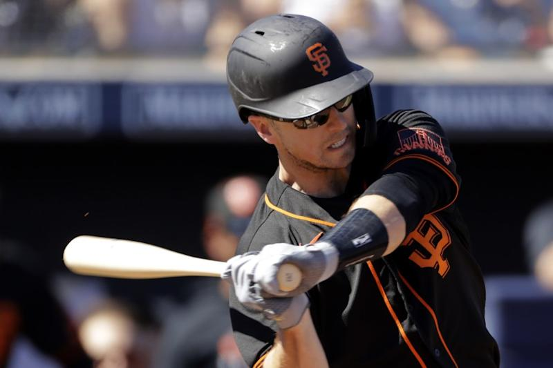 San Francisco Giants' Buster Posey bats during the first inning of a spring training baseball game.