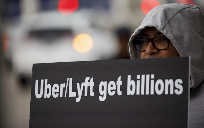 Protests against Uber and Lyft last year - Bloomberg
