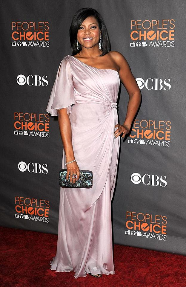 """Taraji P. Henson looked better than ever in a gorgeous one-shoulder goddess gown, chandelier earrings, and a monstrous cocktail ring. Steve Granitz/<a href=""""http://www.wireimage.com"""" target=""""new"""">WireImage.com</a> - January 6, 2010"""