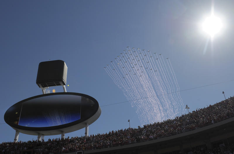 49 planes fly over an NFL football game between the Oakland Raiders and Kansas City Chiefs at Arrowhead Stadium in Kansas City, Mo., Sunday, Oct. 13, 2013. Pilots trailed pink smoke for Breast Cancer Awareness and hoped to set a Guinness world record. (AP Photo/Reed Hoffmann)