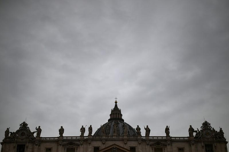 FILE PHOTO: The dome of Saint Peter's Basilica is seen on a rainy day in Saint Peter's Square at the Vatican
