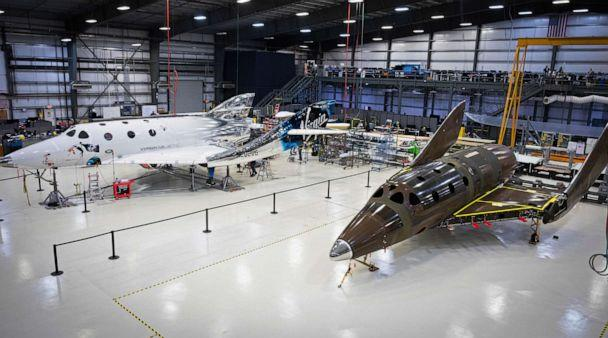 PHOTO: This photo released by Virgin Galactic Wednesday, Jan. 8, 2020, shows Virgin Galactic's next passenger spaceship in a hangar at the company's Mojave Air & Space Port in Mojave, Calif. (Thomas Storesund/Virgin Galactic via AP)