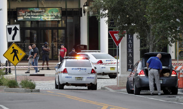 <p>Police cars block off a street near the scene of a mass shooting as law enforcement investigators work on the area at Jacksonville Landing in Jacksonville, Fla., Aug. 26, 2018. (Photo: John Raoux/AP) </p>