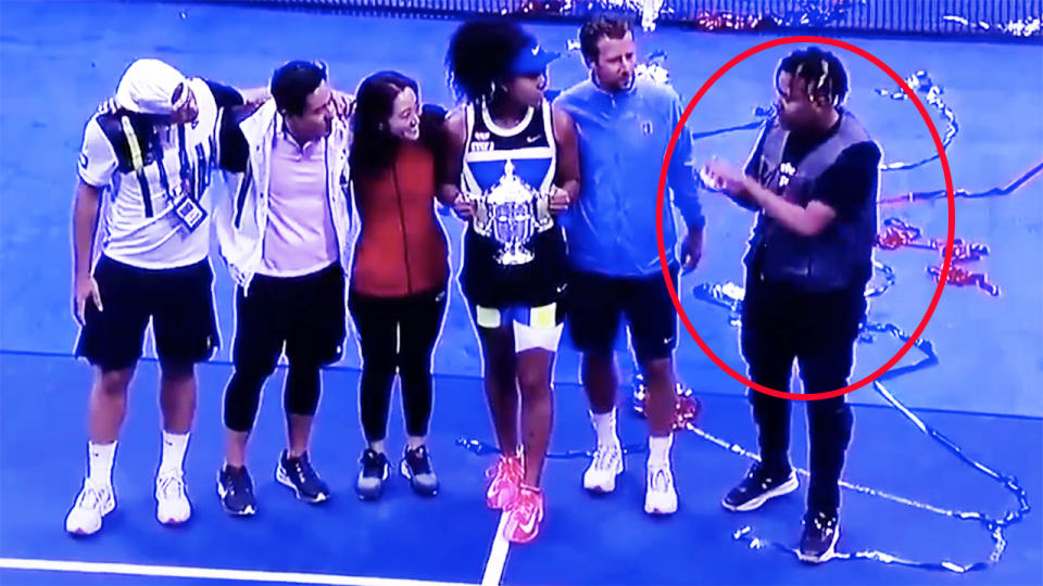 Naomi Osaka, pictured here with her team and boyfriend Cordae after her win in the US Open final.