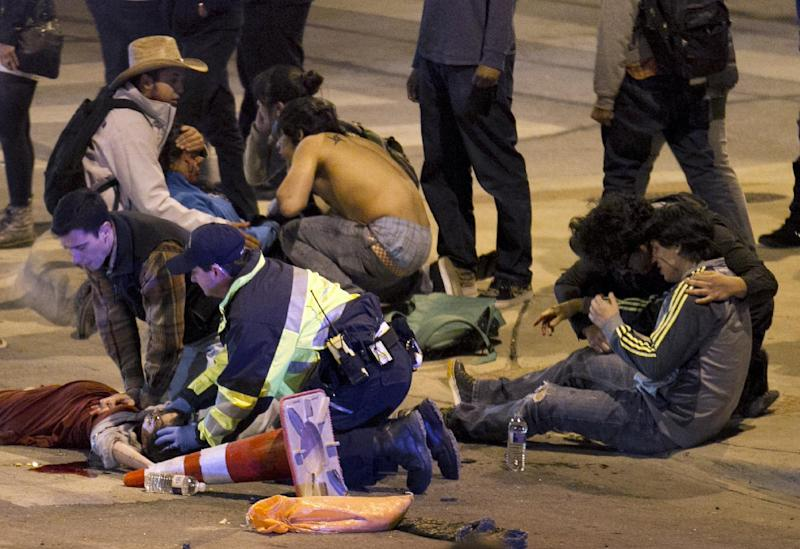 People are treated after being struck by a vehicle on Red River Street in downtown Austin, Texas, on Wednesday March 12, 2014. Police say two people were confirmed dead at the scene after a car drove through temporary barricades set up for the South By Southwest festival and struck a crowd of pedestrians. The condition of the victims shown is unknown. (AP Photo/Austin American-Statesman, Jay Janner) AUSTIN CHRONICLE OUT, COMMUNITY IMPACT OUT, MAGS OUT; NO SALES; INTERNET AND TV MUST CREDIT PHOTOGRAPHER AND STATESMAN.COM