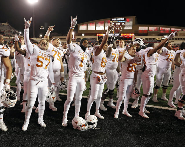 """FILE - In this Nov. 10, 2018, file photo, Texas players sing """"The Eyes of Texas"""" after an NCAA college football game against Texas Tech in Lubbock, Texas. A group of University of Texas football players and athletes across several sports on Friday, June 12, 2020, urged the school to rename several campus buildings, change the traditional school song and donate a percentage of athletic department revenue to organizations supporting the Black Lives Matter movement. (AP Photo/Brad Tollefson, File)"""