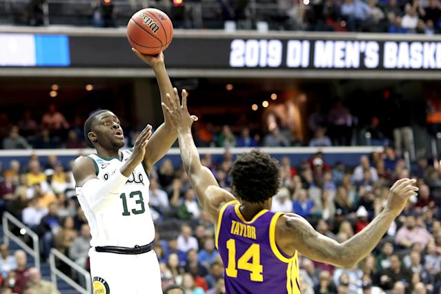 <p>Gabe Brown #13 of the Michigan State Spartans shoots the ball against Marlon Taylor #14 of the LSU Tigers during the second half in the East Regional game of the 2019 NCAA Men's Basketball Tournament at Capital One Arena on March 29, 2019 in Washington, DC. (Photo by Rob Carr/Getty Images) </p>