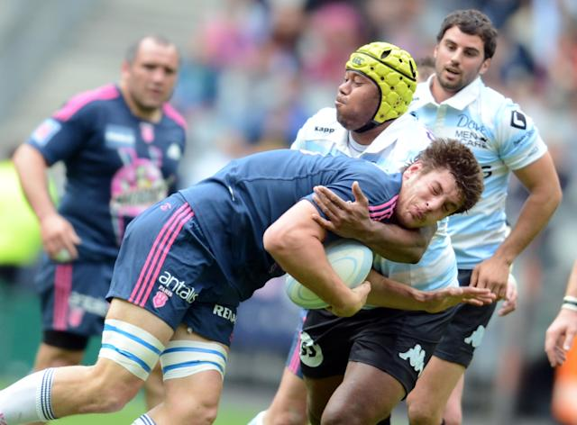 Stade Francais' French lock Alexandre Flanquart (L) and Racing Metro's Fijian flanker Jone Qovu (2nd R) during the French Top 14 rugby union match Stade Francais vs. Racing Metro on May 5, 2012 at the Stade de France stadium in Saint-Denis. AFP PHOTO / FRANCK FIFEFRANCK FIFE/AFP/GettyImages