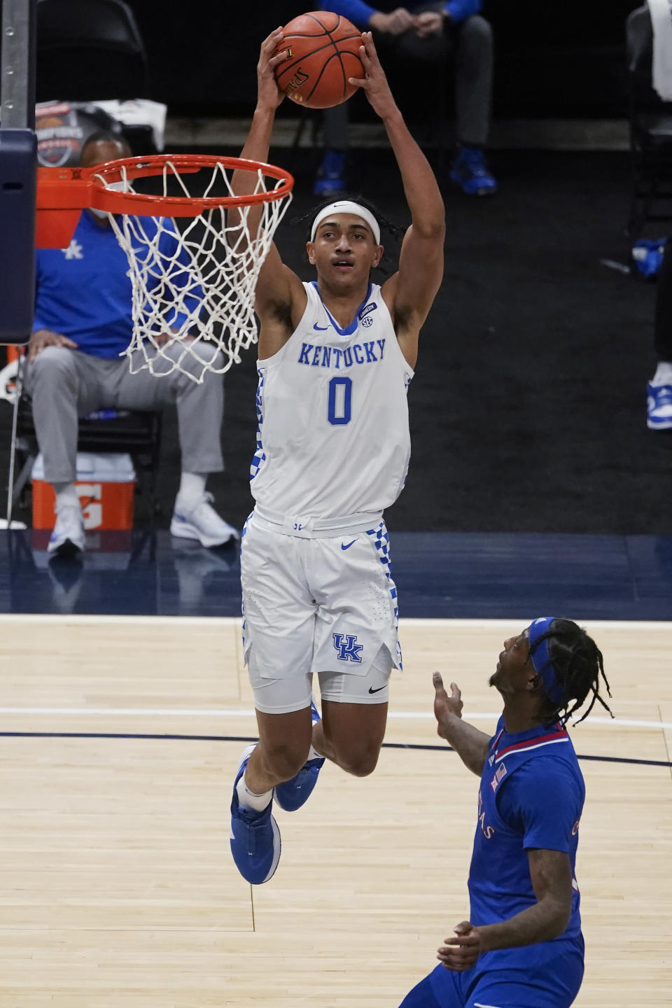 Kentucky's Jacob Toppin (0) goes to the basket against Kansas' Marcus Garrett (0) during the second half of an NCAA college basketball game Tuesday, Dec. 1, 2020, in Indianapolis. (AP Photo/Darron Cummings)