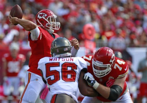 Kansas City Chiefs quarterback Brady Quinn, left, throws a pass as tackle Eric Winston (74) blocks Tampa Bay Buccaneers linebacker Dekoda Watson (56) during the first half of an NFL football game, Sunday, Oct. 14, 2012, in Tampa, Fla. (AP Photo/John Raoux)