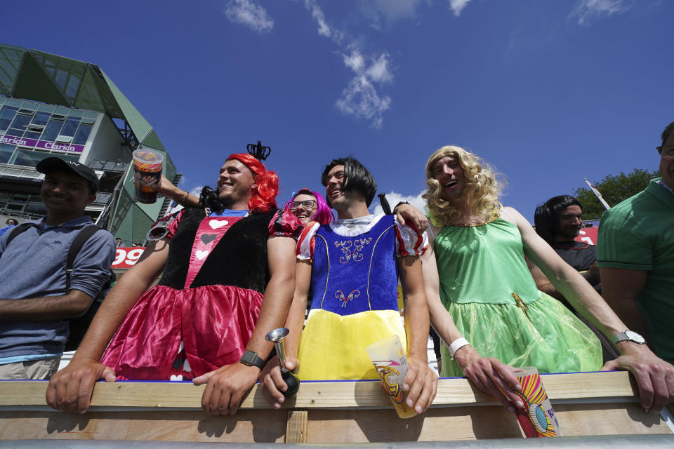 Fans wait to get a close look of the players after England won the third test cricket match between England and India, at Headingley cricket ground in Leeds, England, Saturday, Aug. 28, 2021. (AP Photo/Jon Super)