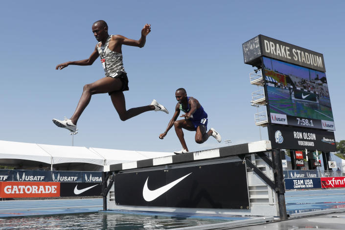 Hillary Bor, left, leaps over the water pit ahead of Stanley Kebenei, right, during the men's 3,000-meter steeplechase at the U.S. Championships athletics meet, Saturday, July 27, 2019, in Des Moines, Iowa. (AP Photo/Charlie Neibergall)