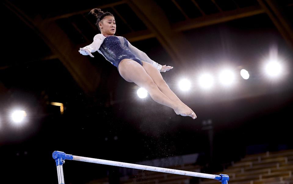 Sunisa Lee competes on the uneven bars